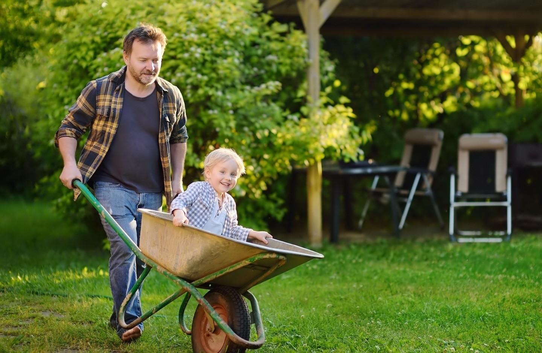man-with-boy-in-wheelbarrow