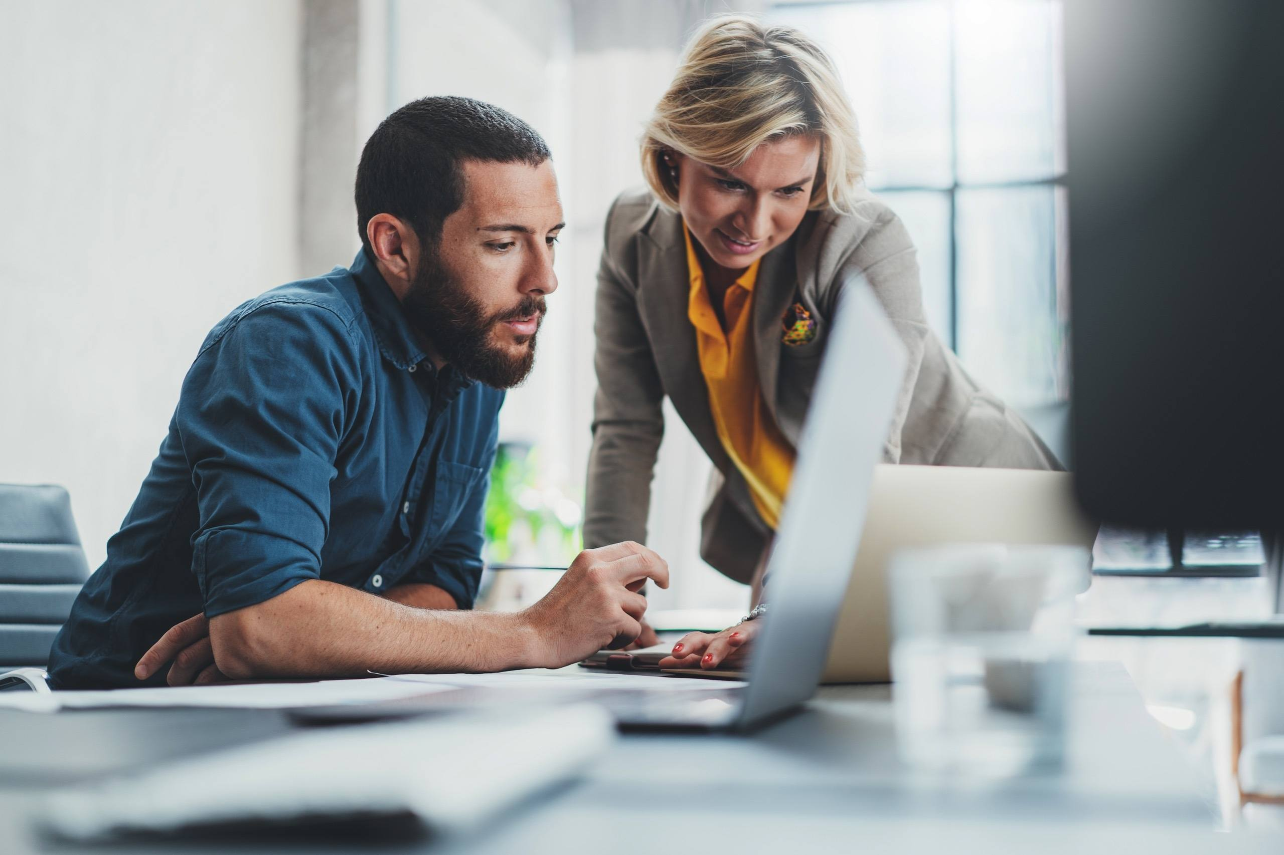 Man and woman looking at loan on computer