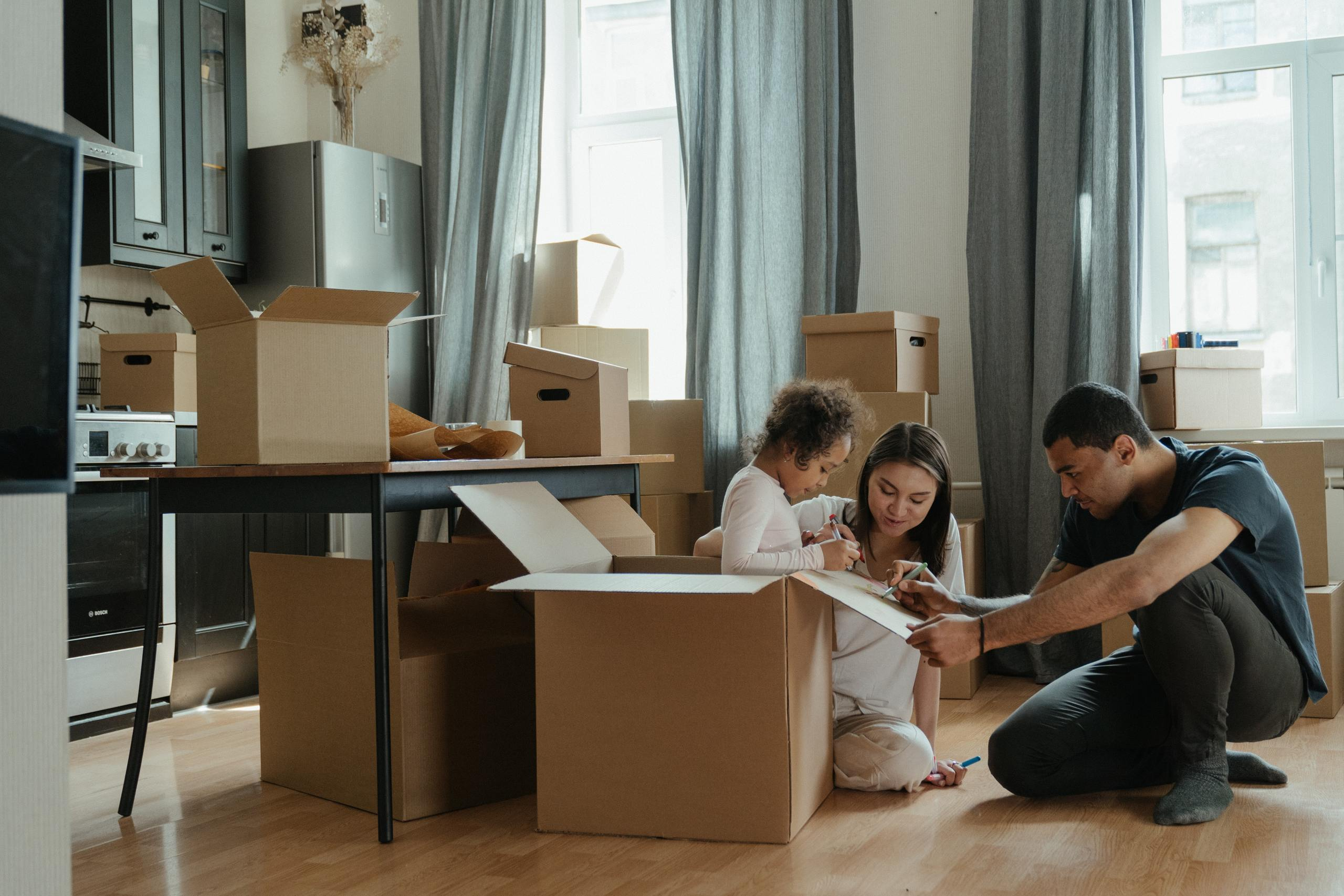 family unpacking after moving 4569340